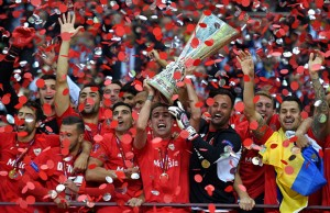 WARSAW, POLAND - MAY 27:  Fernando Navarro of Sevilla lifts the trophy after his team's victory during the UEFA Europa League Final match between FC Dnipro Dnipropetrovsk and FC Sevilla on May 27, 2015 in Warsaw, Poland.  (Photo by Michael Regan/Getty Images)