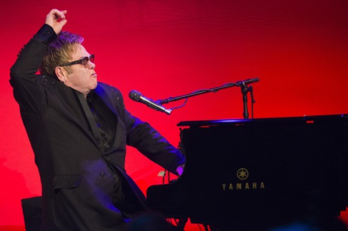 """Elton John performs at the Elton John AIDS Foundation's 13th Annual """"An Enduring Vision"""" benefit at Cipriani's Wall Street on Tuesday, Oct. 28, 2014, in New York. (Photo by Charles Sykes/Invision/AP)"""