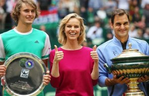 epa06049574 Roger Federer (R) of Switzerland poses with his trophy next to Czech model and actress Eva Herzigova (C) after defeating Alexander Zverev (L) of Germany in their final match of the ATP tennis tournament in Halle, Germany, 25 June 2017.  EPA/TYLER LARKIN