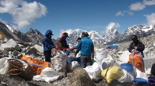 ***EXCLUSIVE*** MOUNT EVEREST, NEPAL - JUNE 2012: Volunteers collect rubbish discarded by climbers on the face of Mount Everest. IT IS Earth's highest peak, but now Mount Everest is in danger of becoming the world's largest rubbish tip. The mountain - which is referred to by the Tibetan's as Chomolungma, Holy Mother in English - has long been tarnished by the waste left by advancing climbers. Many too tired to haul their hefty gear back down the 8,848m peak simply discard it. But a team of volunteers are slowly beginning to change that - restoring the natural wonder to its former glory. In a recent trip they collected and carried down to base camp 1.957 tons of rubbish littering the face of the mountain., Image: 162176874, License: Rights-managed, Restrictions: , Model Release: no, Credit line: Profimedia, Barcroft Media